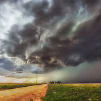 Severe thunderstorm bearing down on a dirt road in eastern New Mexico.