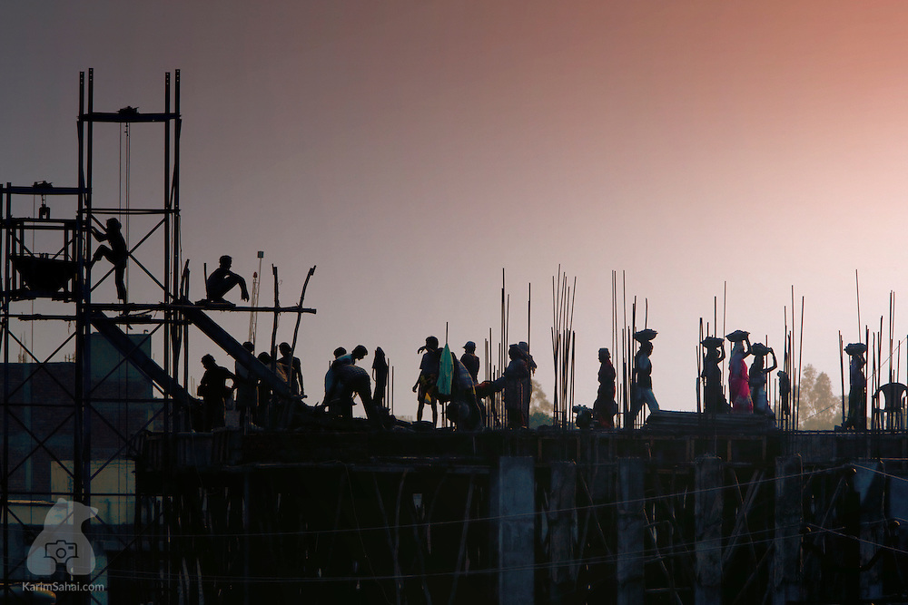 Construction workers on a rooftop, Agra, Uttar Pradesh, India.