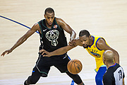 Golden State Warriors forward Kevin Durant (35) fumbles the ball against Milwaukee Bucks forward Khris Middleton (22) at Oracle Arena in Oakland, Calif., on March 29, 2018. (Stan Olszewski/Special to S.F. Examiner)