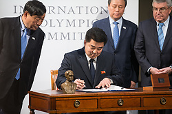 LAUSANNE, Jan. 20, 2018  Lee Hee-beom, president of the PyeongChang Organizing Committee for the 2018 Olympic and Paralympic Winter Games (POCOG), Democratic People's Republic of Korea (DPRK)'s Olympic Committee President and Sports Minister Kim Il Guk, South Korea's Sports Minister Do Jong-hwan and  International Olympic Committee (IOC) President Thomas Bach (From L to R) attend a signing ceremony after a four-party meeting at the IOC headquarter in Lausanne, Switzerland, Jan. 20, 2018. (Credit Image: © Xu Jinquan/Xinhua via ZUMA Wire)