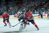 KELOWNA, CANADA - APRIL 8: Alex Overhardt #17 of the Portland Winterhawks checks Dillon Dube #19 of the Kelowna Rockets off the puck during first period on April 8, 2017 at Prospera Place in Kelowna, British Columbia, Canada.  (Photo by Marissa Baecker/Shoot the Breeze)  *** Local Caption ***