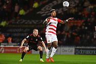 Mallik Wilks of Doncaster Rovers (7) looks to chest the ball down with Dylan McGeouch of Sunderland (8) at his back during the EFL Sky Bet League 1 match between Doncaster Rovers and Sunderland at the Keepmoat Stadium, Doncaster, England on 23 October 2018.