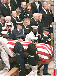 President and Mrs. Bush, with former US Presidents, and other dignitaries watch as the casket of former President Ronald Reagan national funeral service at the National Cathedral in Washington Friday, June 11, 2004. Photo by Chuck Kennedy/KRT/ABACA.