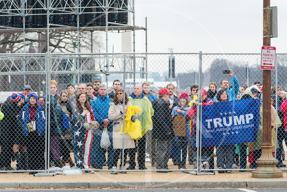 Washington DC, United States - Mall Standing Area attendees look towards the U.S. Capitol at the conclusion of Trump's 2017 inauguration.  A fence stands between them and Union Square ticket holders.