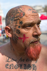 © Licensed to London News Pictures. 21/04/2018. London, UK. A man with English-themed tattoos on his head and body, including a British Bulldog, attends the 'Feast of St George' event in Trafalgar Square, to celebrate the Patron Saint of England. St George's Day is on 23 April. Photo credit : Tom Nicholson/LNP