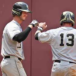 June 04, 2011; Tallahassee, FL, USA; UCF Knights catcher Beau Taylor celebrates with Jonathan Griffin (33) after scoring during the eighth inning of the Tallahassee regional of the 2011 NCAA baseball tournament against the Bethune-Cookman Wildcats at Dick Howser Stadium. Mandatory Credit: Derick E. Hingle