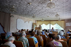 People are seen as attorneys and paralegals hold a Òspecial consultationÓ for potential clients who are children of the Second World War, Rivne, Ukraine, June 15, 2011. This vulnerable group is made up of seniors, most of whom are not receiving proper compensation as promised by the government. The legal team advises them on how to properly fill out forms and submit them to the courthouse, while encouraging them not to give up on their rights. More than half of the worldÕs population, four billion people, live outside the rule of law, with no effective title to property, access to courts or redress for official abuse. The Open Society Justice Initiative is involved in building capacity and developing pilot programs through the use of community-based advocates and paralegals in Sierra Leone, Ukraine and Indonesia. The pilot programs, which combine education with grassroots tools to provide concrete solutions to instances of injustice, help give poor people some measure of control over their lives.