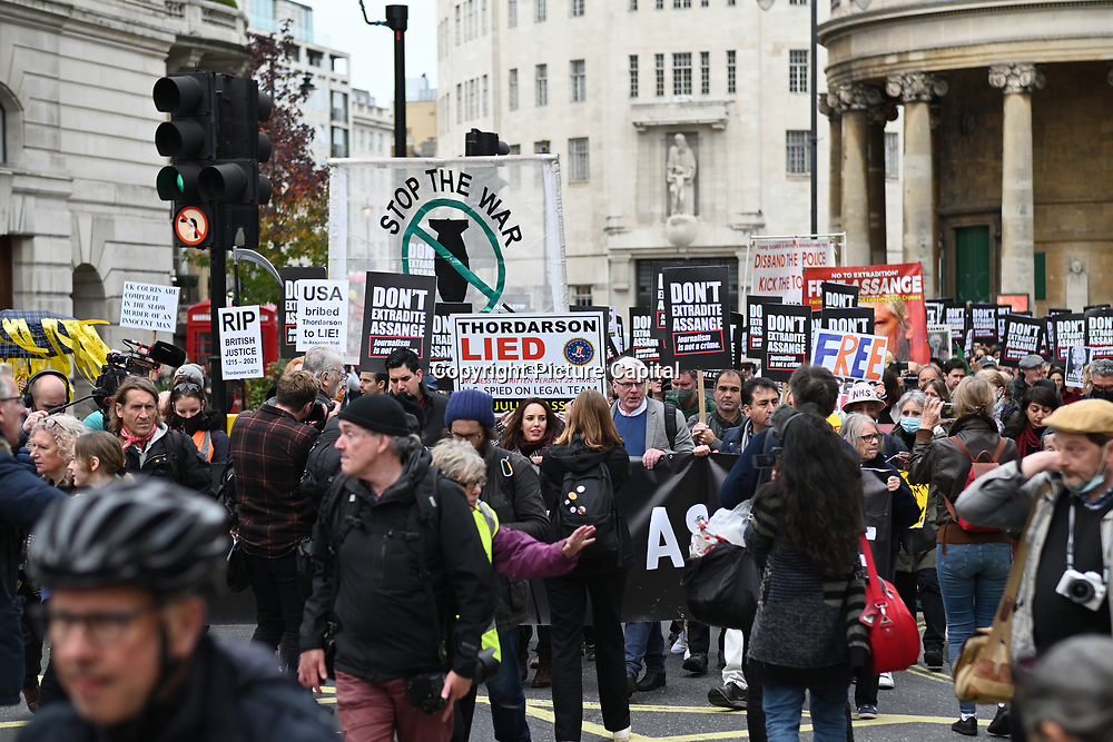 Hundreds supporters March for Assange freedom assembly at BBC march to Royal Court of Justice, 23 October 2021, London, UK.