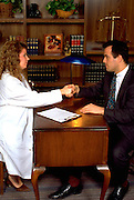 Doctor shaking hands with Argentinean  patient ages 32 and 33.  St Paul Minnesota USA
