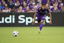 May 13, 2018 - Orlando, FL, U.S. - ORLANDO, FL - MAY 13: Orlando City defender Mohamed El-Munir (13) chases down the ball during the soccer match between the Orlando City Lions and Atlanta United on May 13, 2018 at Orlando City Stadium in Orlando, FL. (Photo by Joe Petro/Icon Sportswire) (Credit Image: © Joe Petro/Icon SMI via ZUMA Press)