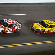 NASCAR Sprint Cup driver Kevin Harvick (29) and Joey Logano (22) are seen in turn four of the NASCAR Sprint Unlimited Race at Daytona International Speedway on Saturday, February 16, 2013 in Daytona Beach, Florida.  (AP Photo/Alex Menendez)