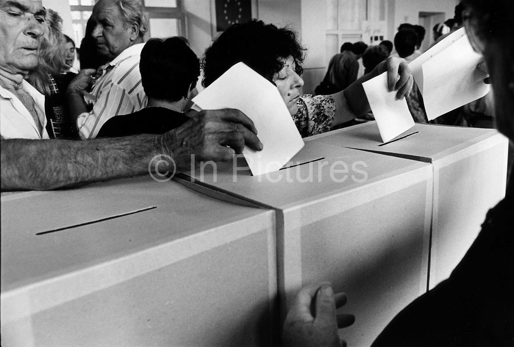 """Voting in the elections for the future of integration in the town as part of the Dayton Peace Accords. The town  was destroyed by systemic bombardment from Croat guns during the Croat Muslim War, when the Croats endeavored to """" cleanse"""" the town of non Croats. Mostar, Bosnia and Herzegovina."""