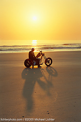 """Jesse James. Daytona Beach, FL. 2000<br /> <br /> Limited Edition Print from an edition of 50. Photo ©2000 Michael Lichter.<br /> <br /> The Story: The '60s movie """"Endless Summer"""" comes to mind. It's a classic, just like Jesse.  I could see him in the movie, swapping bikes for surfboards and searching the world for the perfect ride, only to be happy to get back home where it can't get any better.  The movie inspired many to follow their passion. Isn't that Jesse?"""