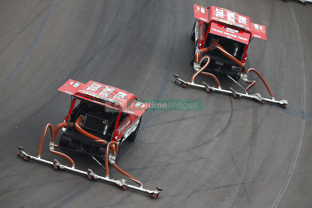 March 10, 2018 - Avondale, Arizona, United States of America - March 10, 2018 - Avondale, Arizona, USA: The Air Titan Trucks work to dry the track during a rain delay for the DC Solar 200 at ISM Raceway in Avondale, Arizona. (Credit Image: © Chris Owens Asp Inc/ASP via ZUMA Wire)