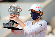 Ina SWIATEK (POL) won the match, celebration with the trophy over Philippe Chatrier stadium during the Roland Garros 2020, Grand Slam tennis tournament, women single final, on October 10, 2020 at Roland Garros stadium in Paris, France - Photo Stephane Allaman / ProSportsImages / DPPI