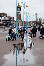 © Licensed to London News Pictures.09/04/2012, Skegness, North Lincolnshire, UK. Bank Holiday Monday weather, Skegness sea front.Pictured, families step over the puddles on the way to the sea front. Photo credit : Dave Warren/LNP