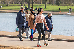 """© Licensed to London News Pictures. 24/02/2021. London, UK. A roller skater enjoys the sunshine and mild temperatures this afternoon in Hyde Park, London as weather forecasters predict a warm and sunny week ahead with highs of 17c in London today. This week, Prime Minister Boris Jonson announced his """"Roadmap Map' out of Lockdown with a gradual easing of Covid-19 restrictions with shops, pubs and gyms to open by April, Rule of Six and schools back by March and nightlife back by June. Photo credit: Alex Lentati/LNP"""