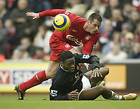 Fotball<br /> England 2004/22005<br /> Foto: SBI/Digitalsport<br /> NORWAY ONLY<br /> <br /> Liverpool v Manchester United<br /> FA Barclays Premiership.<br /> 15/01/2005.<br /> Liverpool's Jamie Carragher and United's Louis Saha