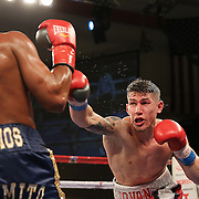 KISSIMMEE, FL - MARCH 06:  Jeffrey Ramos (L) trades punches with Jovan Perez during the Telemundo Boxeo boxing match at the Kissimmee Civic Center on March 6, 2015 in Kissimmee, Florida. Ramos won the bout by split decision. (Photo by Alex Menendez/Getty Images) *** Local Caption *** Felix Verdejo; Sergio Villanueva
