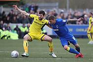 AFC Wimbledon striker Cody McDonald (10) battles for possession with Oxford United defender John Mousinho (30) during the EFL Sky Bet League 1 match between AFC Wimbledon and Oxford United at the Cherry Red Records Stadium, Kingston, England on 10 March 2018. Picture by Matthew Redman.