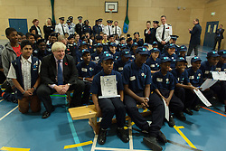 © Licensed to London News Pictures.30/10/2013. London, UK. The Mayor of London Boris Johnson visits the Southwark's volunteer police cadets at Walworth Academy.Photo credit : Peter Kollanyi/LNP
