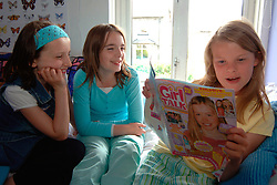 young pre-teens in the bedroom