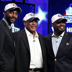 06 February, 2010: Jerry Rice, Floyd Little and Emmitt Smith pose for photos on stage after they were announced as three of the newest Enhrinees into the Hall of Fame during a press conference for the Pro Football Hall of Fame Class of 2010 Enshrinees held at the Greater Ft. Lauderdale/Broward County Convention Center in Fort Lauderdale, Florida.