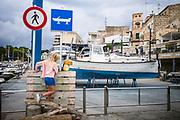 Porto Cristo, Mallorca, Girl playing along the shipyard. 17-08-2018