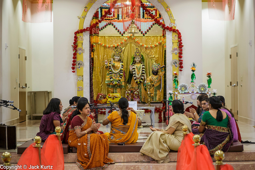 10 AUGUST 2012 - PHOENIX, AZ:    Women sing and pray during the celebration of Janmashtami at Ekta Mandir, a Hindu temple in central Phoenix. Janmashtami is the Hindu holy day that celebrates the birth of Lord Krishna. Hindu communities around the world celebrate the holy day. In Arizona, most of the Hindu temples in the Phoenix area have special celebrations of the day..PHOTO BY JACK KURTZ