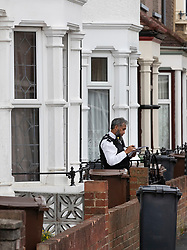© Licensed to London News Pictures. 19/07/2019. London, UK. Police guard a house where it is reported that the body of a woman was found on fire in the back garden of a property in Chadwell Heath, East London. Fire fighters arrived at the house and then called in the police when they found the woman. Photo credit: Peter Macdiarmid/LNP
