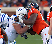 CHARLOTTESVILLE, VA- NOVEMBER 12:  Guard Dave Harding #74 of the Duke Blue Devils blocks defensive tackle Will Hill #93 of the Virginia Cavaliers during the game on November 12, 2011 at Scott Stadium in Charlottesville, Virginia. Virginia defeated Duke 31-21. (Photo by Andrew Shurtleff/Getty Images) *** Local Caption *** Dave Harding;Will Hill