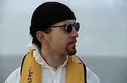 The Edge photographed on the Rainbow Warrior at a U2 Greenpeace protest at the Sellafield Nuclear Plant in June 1992.