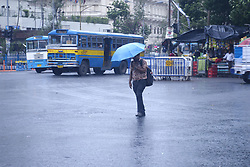 May 31, 2017 - Kolkata, West Bengal, India - Pedestrian hold umbrella due to sudden shower in Kolkata on May 31. Pre monsoon shower observe different parts of West Bengal. Southwest Monsoon has arrived on Kerala on May 30; simultaneously Monsoon has also covered parts of Northeast India. (Credit Image: © Saikat Paul/Pacific Press via ZUMA Wire)