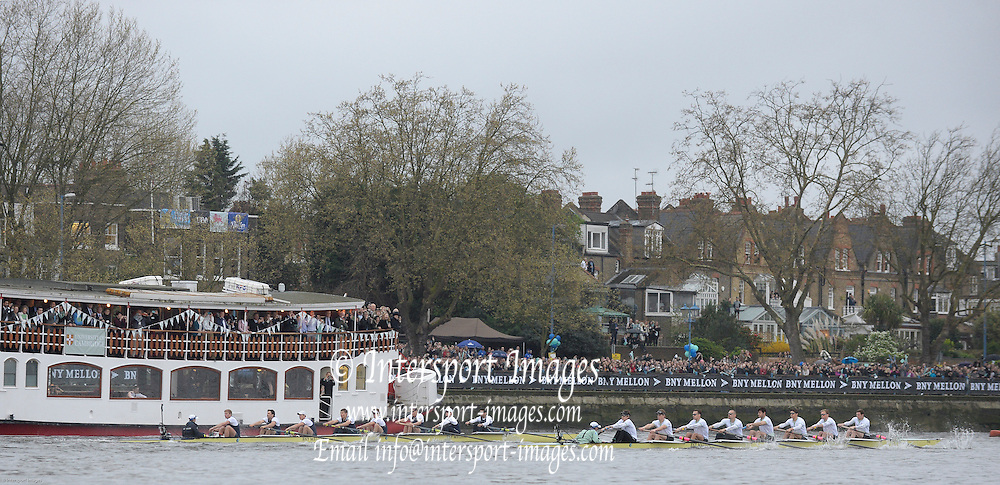 London, United Kingdom.  Both crews at the beginning of the  2014 Varsity Boat Race between Oxford University and Cambridge University Boat Clubs, as they head twords Putney Hard during the race over the   Championship Course, Putney to Mortlake,  River Thames;   17:58:07 - Sunday  - 06/04/2014  [Mandatory Credit; Peter SPURRIER/Intersport Images].