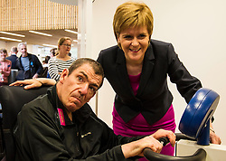 Pictured: Brian met the First Minister and showed how he has pro=gressed with the help of the centre<br /> <br /> The First Minister Nicola Sturgeon, MSP, joined people supported by the Thistle Foundation to bury a time capsule to mark the opening of a new health and social care centre. <br /> Ger Harley | EEm 14 June 2016