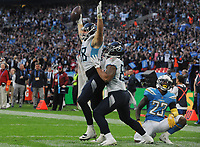 American Football - 2018 NFL Season (NFL International Series, London Games) - Tennessee Titans vs. Los Angeles Chargers<br /> <br /> Luke Stocker of the Titans (88) celebrates his late touchdown to give them hope,as Rayshawn Jenkins shows his anguish at Wembley Stadium.<br /> <br /> COLORSPORT/ANDREW COWIE