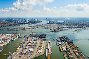 Nederland, Zuid-Holland, Rotterdam, 10-06-2015;  Waalhaven (WestZijde) gezien naar rivier de Nieuwe Maas en skyline Rotterdam centrum. <br /> Uniport Multipurpose Terminals container terminal in de voorgrond.<br /> Waal harbour (West side) seen in the direction of Nieuwe Maas river and the skyline of Rotterdam.<br /> luchtfoto (toeslag op standard tarieven);<br /> aerial photo (additional fee required);<br /> copyright foto/photo Siebe Swart