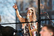 05 November 2012:  Aerosmith's Steven Tyler points to fans in the window of his old apartment during a free concert in Boston's Allston neighborhood in front of the apartment building, 1325 Commonwealth Ave, which was the band's home in the early 1970's.  Boston, MA. ***Editorial Use Only*****