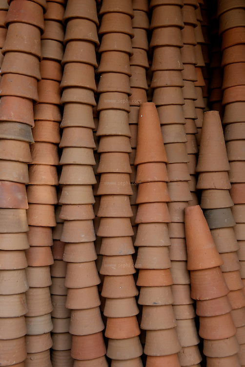 Kulhars, cley cups traditinaly used for drinking lassi, stacked up in a warehouse near the lassi stall. Jaipur, April 2007