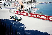Formula One motor racing Monaco Grand Prix 1961, Jim Clark in Lotus-Climax tobacconist kiosk corner
