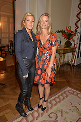 Left to right, ELLIE GOULDING and BROOKE BARZUN at a party hosed by the US Ambassador to the UK Matthew Barzun, his wife Brooke Barzun and editor of UK Vogue Alexandra Shulman in association with J Crew to celebrate London Fashion Week held at Winfield House, Regent's Park, London on 16th September 2014.