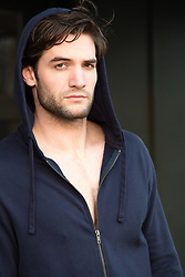 portrait of a handsome on a in hoodie