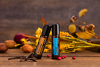 Two essential oils in a fall setting.