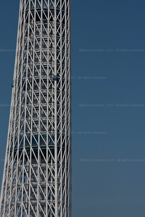 Abstract on the lattice work of beams that are Tokyo Sky Tree. In this image this new telecommunication tower stands at 398 metres and when finished will measure 634 metres from top to bottom making it the tallest structure in East Asia. Oshiage, Tokyo, Japan June 21st 2010