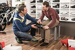 Man buying sports shoes