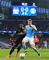 Kevin De Bruyne of Manchester City is challenged by Serge Aurier of PSG - Mandatory byline: Matt McNulty/JMP - 07966386802 - 12/04/2016 - FOOTBALL - Etihad Stadium -Manchester,England - Manchester City v Paris Saint-Germain - UEFA Champions League - Quarter Final Second Leg