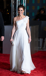 Catherine, Duchess of Cambridge, wearing a white one-shouldered Alexander McQueen dress, attends the EE British Academy Film Awards at the Royal Albert Hall in London on February  10, 2019.