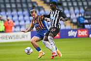 Jason Cummings of Shrewsbury Town and Rosaire Longelo  of Newcastle United during the EFL Trophy match between Shrewsbury Town and U21 Newcastle United at Greenhous Meadow, Shrewsbury, England on 22 September 2020.