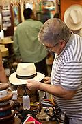 A hat maker blocks a Panama hat in Old San Juan, Puerto Rico