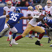 Vernon Davis, San Francisco 49ers, bursts past the tackle of Quintin Demps, New York Giants, during the New York Giants V San Francisco 49ers, NFL American Football match at MetLife Stadium, East Rutherford, NJ, USA. 16th November 2014. Photo Tim Clayton
